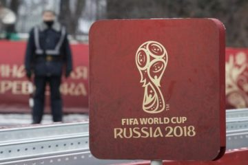 FILE PHOTO - A sign with the logo of the 2018 FIFA World Cup Russia is on display near the Kremlin before the events, dedicated to the upcoming World Cup Final Draw, in central Moscow, Russia November 29, 2017. REUTERS/Sergei Karpukhin